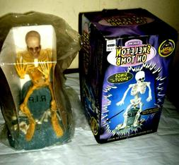 1998 GEMMY DANCING SKELETON ON TOMB LIGHTS, SHAKES, MOVES an