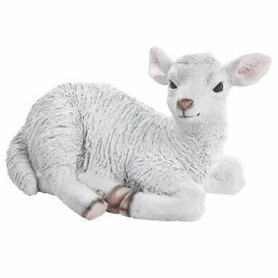 lamb statue farm animal sheep laying down