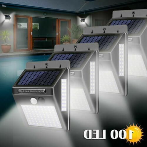 Outdoor 100 LED Solar Lights PIR Motion Sensor Wall Lamp Gar