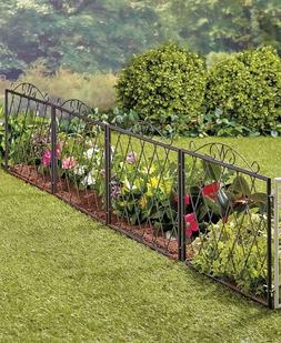 scrolled metal garden fence yard lawn outdoor